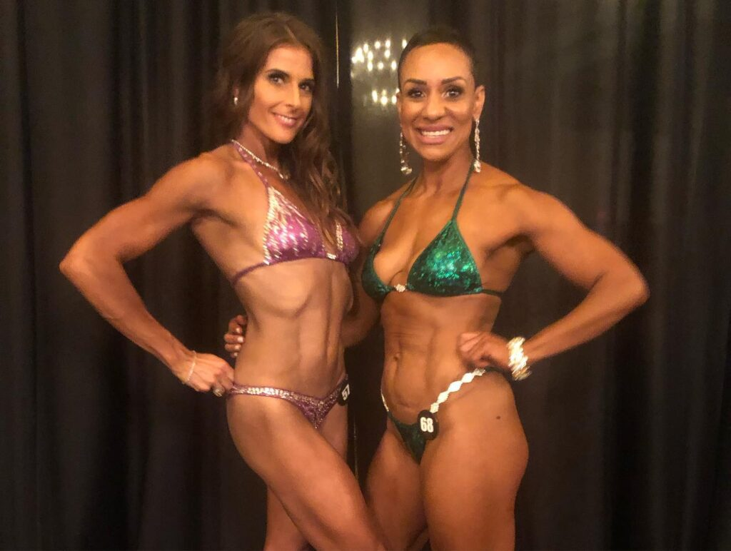 Sabrina and Ebony posing at bikini competition